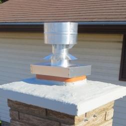 Aluminum flue tile cover and raincap.