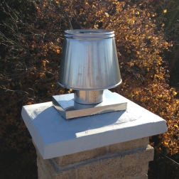 One of our flue tile covers with an anti-downdraft cap attached.